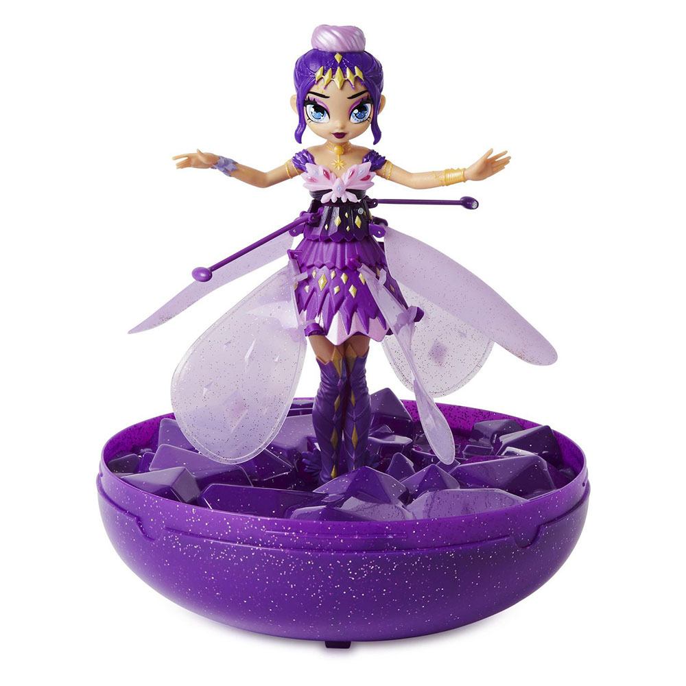 Purple Hatchimals Pixie Crystal Flyer with arms outstretched standing in purple launcher