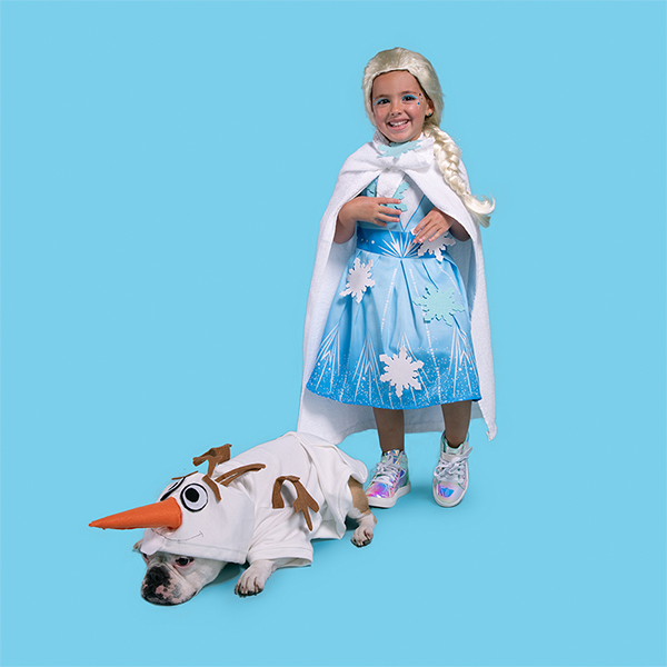 Young girl and dog dressed in DIY Elsa and Olaf costumes