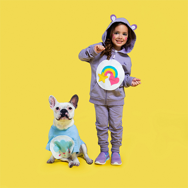 Young girl and dog dressed in DIY Carebear costumes