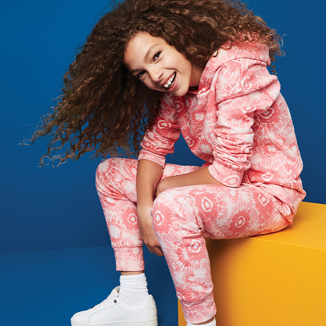 Girl in a pink patterned sweatsuit